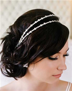 Classic with just enough sparkle! Double headband of various sized Swarovski rhinestones is perfect for many dresses and versatile with many bridal hairstyles. Available in silver only.