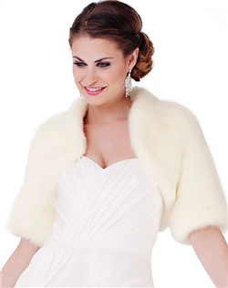 "Designed to reveal neckline details, this flashy little 14"" jacket has 3/4 elbow length sleeves. This jacket is designed to be worn open.  Cropped length, built-in collar, satin lining. Available in ivory and blush."