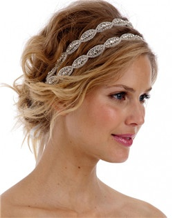 Our most popular crystal headband! This piece is made from two 14 inch rows of gorgeous rhinestone trim and is attached to satin ribbon ties in the color of your choice (White or Vintage Ivory). The ends of the ribbon are also embellished front and back with trim detail for the perfect finishing touch.