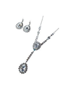 "This stunnig necklace and earring set can be made with tiffany blue crystals incorporated into the necklace design to act as the bride's ""something blue"" item or be made with all clear crystals."