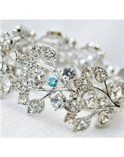 "This crystal leaf design stretch bracelet is a perfect addition to any wedding day look. It can be made with a tiffany blue crystal incorporated into its design to act as the bride's ""something blue"" item or be made with all clear crystals."