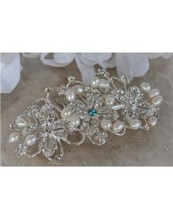 "This beautiful hair comb is covered with stunning crystals and accented with hand woven freshwater pearls. It can be made with a tiffany blue crystal incorporated into its design to act as the bride's ""something blue"" item or be made with all clear crystals."