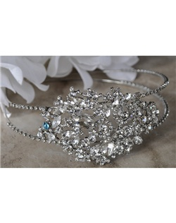 "This side accent headband has stunning princess cut rhinestones that cascade up to a beautiful design consisting of multishaped gemstones and sparkling round crystal rhinestones.  It can be made with a tiffany blue crystal incorporated into its design to act as the bride's ""something blue"" item or be made with all clear crystals."