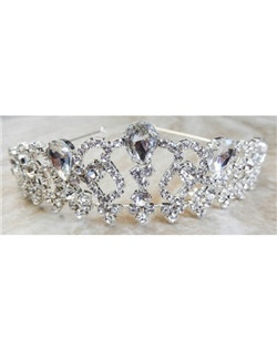 "This dazzling tiara can be made with a tiffany blue crystal incorporated into its design to act as the bride's ""something blue"" item or be made with all clear crystals."