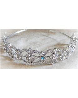"This elegant victorian style headband can be worn by itself or with coordinating necklace and earrings. It can be made with a tiffany blue crystal incorporated into its design to act as the bride's ""something blue"" item or be made with all clear crystals."