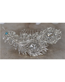 "This unique hair comb is covered with stunning crystals.  It can be made with a tiffany blue crystal incorporated into its design to act as the bride's ""something blue"" item or be made with all clear crystals."