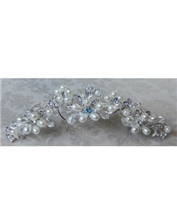 "This handmade flower hair comb has an array of beautiful rhinestones, Swarovski crystals and pearls.  It can be made with a tiffany blue crystal incorporated into its design to act as the bride's ""something blue"" item or be made with all clear rhinestones."