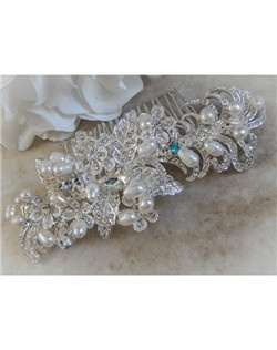 "This beautiful leaf and petite flower design hair comb is covered with dazzling crystals and accented with hand woven freshwater pearls. It can be made with a tiffany blue crystal incorporated into its design to act as the bride's ""something blue"" item or be made with all clear crystals."