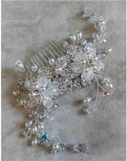 "This handmade floral hair comb is absolutly beautiful.  The silver floral design features creamy freshwater pearls, clear Swarovski crystals and rhinestones.  It can be made with a tiffany blue crystal incorporated into its design to act as the bride's ""somehing blue"" item or be made with all clear crystals."