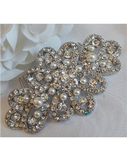 "This stunning vintage inspired hair comb is covered in beautiful crystals and accented with hand woven pearls. It can be made with a a tiffany blue crystal incorporated into its design to act as the bride's ""something blue"" item or be made with all clear crystals."