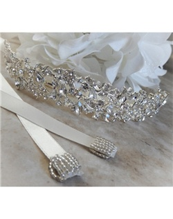 "This dazzling ribbon headband is covered with marquise, round and pear shaped crystals.  It can be made with a tiffany blue crystal incorporated into its design to act as the bride's ""something blue"" item or be made with all clear crystals."