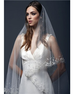 "108"" classic veil scattered with crystals and a handbeaded trim adorned with silk floral appliques.  All veils are customizable to any length in a variety of standard colors."