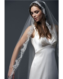 "108"" veil classically embroidered and handbeaded with swarovski crystals and freshwater pearls.  All veils are customizable to any length in a variety of standard colors."