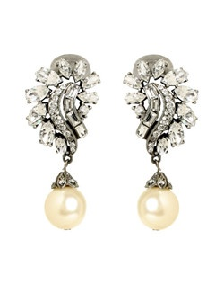 These gorgeous crystal bridal earrings radiate classic glamour. Their striking combination of round brilliant, marquise, and baguette cut crystals, and their eye-catching pearl drop, will make these a dazzling addition to your wedding jewelry.