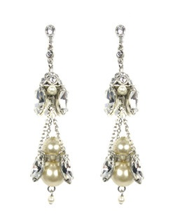Like a beautiful chandelier, these earrings have layers of Swarovski crystals and pearls. The pearls mirror the hue of a wedding dress perfectly! These unique chandelier earrings will add just the sparkle and style you are looking for.