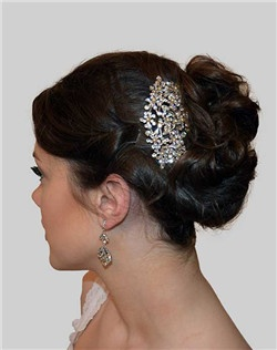 This stunning Swarovski crystal and ivory pearl comb is a Bella Bleu favorite! So versatile and can be worn will many different hairstyles....half up/half down, high bun/chignon, down style off to the side, and a messy up do! Designed with the quality workmanship that Paris is known for, this comb is a perfect addition to your bridal look.
