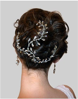 This beautiful crystal up-do headpiece is perfect to cover a bun or work into an up-do. Crafted with Swarovski crystals and rhodium plate.