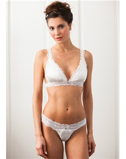 Low rise silk thong with doubled lace waistband.  93% Silk 7% Spandex exclusive of trim. Organic bamboo rayon liner.