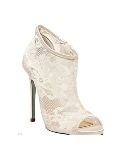 "The RSVP by Betsey Johnson is a gorgeous full lace bootie. The peep toe front adds a dash of interest to this stunning style. The sheer lace fabric is sexy, sophisticated and fun all in one. The heel height measures 4.75"" with a light platform toe front. Available in Ivory lace with a side zipper closure."