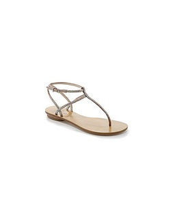 "The Ellie by Pelle Moda is a T-strap sandal design perfect for any event. The simple design and thin straps make this style feminine and sophisticated while fun and functional. The straps are encrusted in AB rhinestones that glitter and sparkle. The 3/4"" heel give a little lift. Available in Blush Satin with AB rhinestones."