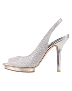 "The Rivka by Pelle Moda is a modern peep toe slingback. The Silver vamp materials are textured with a cross hatch design while the heel is a solid metallic and features an adjustable slingback design. The center set 1/2"" platform creates interest as well as comfort and support for the  4"" heel. Available in Silver."