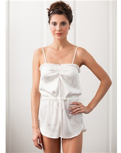 Playful silk romper with silk chiffon ruffle.  Ties at waist, straps adjust at back.  93% Silk 7% Spandex.