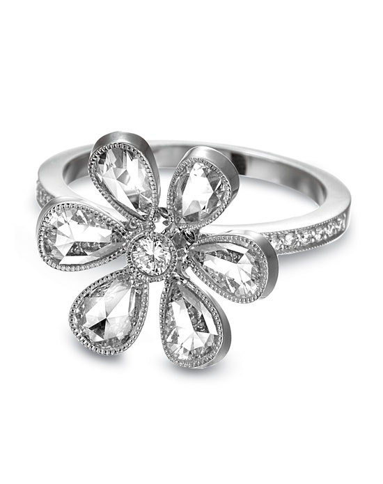John Apel platinum fashion ring with rose-cut and micro-pave full-cut diamonds.