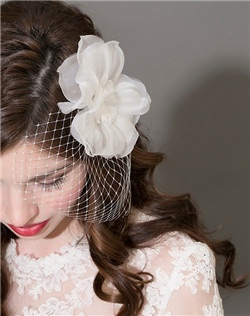 Floral Fascintator with french net veiling