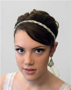 The Martine Headpiece is so versatile! It can be worn as a headband, halo, around the forehead or wrapped around a bun! Intertwined Swarovski rhinestone chain with ivory organza ribbon closure.