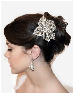 This large silver flower and leaf filigree is heavily encrusted with handset pearls and Swarovski rhinestones to resemble e a piece of antique lace. Set on a clip for easy styling.