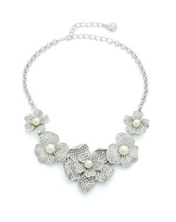 Let your wedding jewelry take inspiration from the beauty of nature with this stunning pearl and crystal bridal necklace from designer Kenneth Jay Lane. Sparkling Swarovski crystal flowers seem to bloom around your neck while iridescencent pearls glow from within their petals.