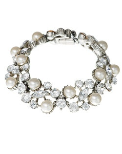 Let your wedding jewelry evoke the elegance of a bygone era with this vintage inspired pearl and crystal bridal bracelet from designer Ben Amun. Sparkling marquise and round cut Swarovski crystals mix beautifully with shimmering pearls in this undeniably feminine design.