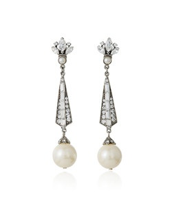 With their dramatic three inch length, these pearl and crystal bridal earrings from designer Ben Amun simply exude sophisticated glamour. A crest of marquise cut crystals tops these pretty earrings that feature a long, narrow drop leading to a luminous dangling pearl. A perfect choice to bring sparkle, movement, and subtly vintage style to your wedding jewelry look.