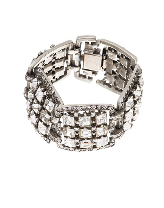 If high glamour and serious splarkle are what you desire for your wedding day jewelry, look no further. This silver plated bridal bracelet from designer Ben Amun is a true show-stopper with its repeating pattern of large square cut crystals surrounded by pavé.