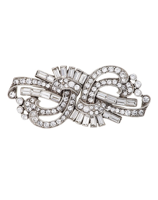 Bring a touch of vintage elegance to your wedding day ensemble with this striking crystal bridal pin from designer Ben Amun. Round brilliant and baguette cut Swarovski crystals combine beautifully in a silver plated setting that forms a charming swirl design. Effortlessly chic.