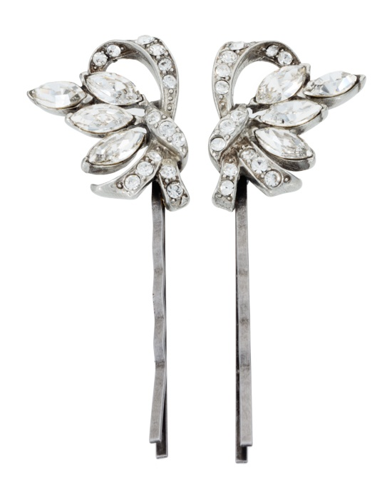 Sparkling marquise cut Swarovski crystals light up this pretty pair of hair pins from designer Ben Amun. With their divine vintage style and serious sparkle, these are sure to add a touch of glamour to any look.