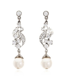 If timeless elegance is what you seek for your wedding jewelry, look no further than these exquisite pearl and crystal bridal earrings from designer Ben Amun. The unstoppable sparkle of Swarovski crystals ensures that these earrings catch the eye, while their dramatic two inch length allows the pearl drops to rest flatteringly at the jaw line.