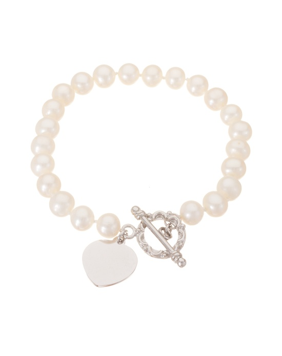 Sometimes the simplest designs are the most elegant, and what could be more elegant than a row of cultured freshwater pearls around your wrist? With its beautiful, iridescent shimmer and its sweet toggle style heart clasp, this classic pearl bracelet from Thomas Laine Pearls will add a touch of effortless chic to any outfit. **Looking for a timeless and utterly wearable jewelry choice for your bridesmaid gifts? In our collection of freshwater pearl and sterling silver jewelry you will find beautiful options to suit every style.