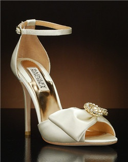 Open toe d'orsay heel with ankle strap and bow detail