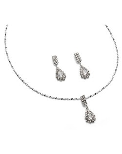 Contemporary jewelry set with a large sparkling clear Austrian rhinestone surrounded by smaller stones.