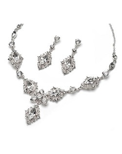 Clear crystal rhinestones and a silver plated swirling design grace this bridal necklace and earring set.