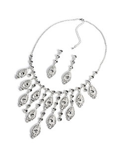 This piece is adorned with glistening rhinestones amongst an elegant design that cascades beautifully along the neckline.