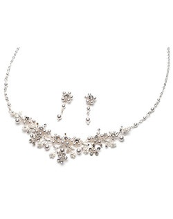 Jewelry set is finely hand crafted with Genuine Austrian Crystals accented with delicate soft white faux pearls.
