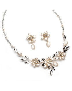 This silver-plated necklace and earring set features an arrangement of frosted soft white beads, rhinestones, and white simulated pearls in a delicate floral design.