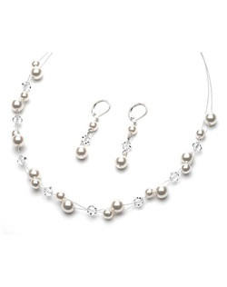 This jewelry set features glass pearls and multi-faceted crystals that sit along this illusion necklace.