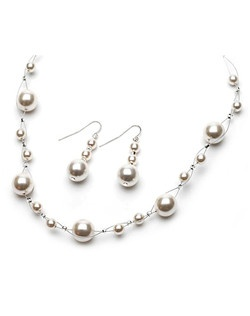 "The pearls are hand-wired on illusion wire so that the pearls seem to ""float"" along the neckline."