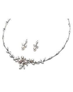 This silver plated wedding jewelry set is made with diamond white pearls and Cubic Zirconia stones in a floral vine detailing.