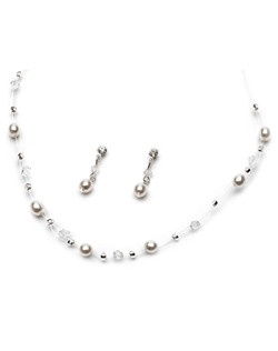 Pearl Illusion Jewelry Set features a combination of faux pearls and clear crystals that seemto float along the neckline.