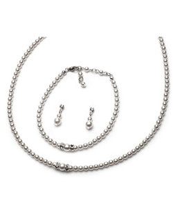 The necklace made of lustrous, soft glass pearls is accented with two strands of sparkling rhinestones.