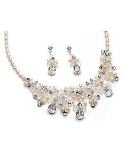 This jewelry set is all hand wired and features brilliant Swarovski Crystals, sparkling rhinestones and fresh water pearls.